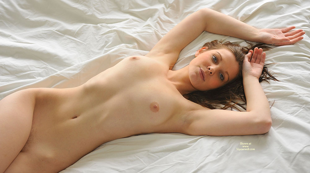 Lying Naked On The Bed