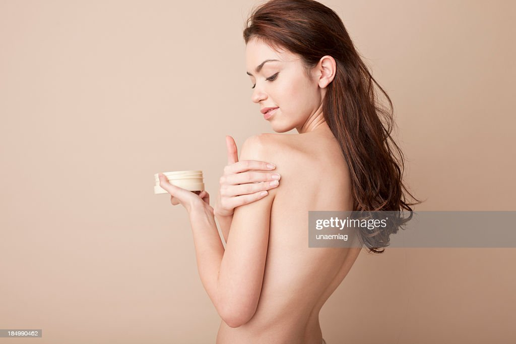 Naked Woman Rubbing Lotion